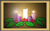 Advent wreath with three candles lit.