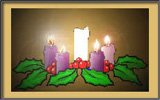Advent wreath with four candles lit.