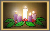Advent wreath with central candle lit.